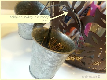 """Bobby pins are attaching the """"sidecar"""" tins"""