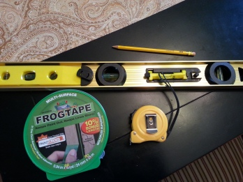 level, frog tape, pencil, tape measure